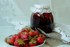 Bank with strawberry jam Stock Photo