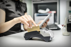 Bank terminal and tablet pc. Female hand holding  bank terminal and tablet pc Royalty Free Stock Images