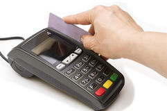 Bank terminal and a woman`s hand with a credit or debit card to make payments. Toned photo stock photography