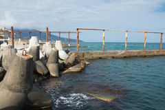 Bank tetrapods on the shore of the Black sea. Pier. Royalty Free Stock Image