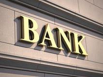 Bank undertecknar på byggnad Arkivfoto