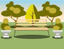 Bank unter einem Baum im Park Stockfoto