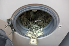 Bank van dollars in wasmachine royalty-vrije stock fotografie