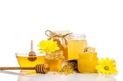 Bank van honing met honingraten, glaskom met honing Royalty-vrije Stock Foto's