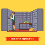 Bank vault room with a clerk and deposit boxes Royalty Free Stock Photography
