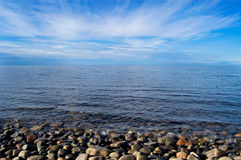 On the bank of the White sea. The stony coast of northern White sea filled in with the bright morning sun Stock Photos