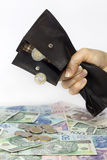 Bank wife and tax squeezed polish money Stock Image