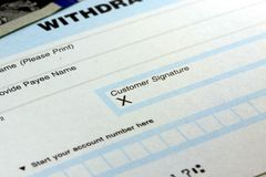 Bank withdrawal slip - Customer Signature Stock Images