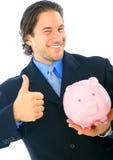 banka biznesmena szczęśliwy mienia prosiątko Zdjęcia Royalty Free
