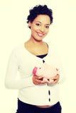 banka mienia prosiątka kobieta w ciąży Obraz Royalty Free