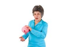 banka pusta prosiątka seniora kobieta Zdjęcia Stock
