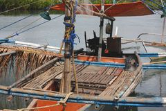 Bangkas, a traditional type of outrigger boats used by Filipino artisanal fishermen. Bankas or bangkas are traditional outrigger wooden boats used by Filipino Royalty Free Stock Images