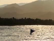 Bangkas, a traditional type of outrigger boats used by Filipino artisanal fishermen. Bankas or bangkas are traditional outrigger wooden boats used by Filipino Stock Image
