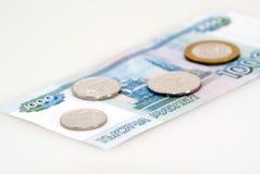 Bankbiljet en muntstukken Stock Foto's