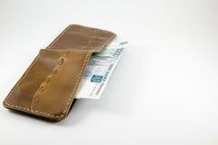 Bankbiljetten die uit een beurs plakken Stock Foto