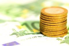 Bankbiljetten en muntstukken Stock Fotografie