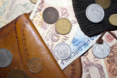 Bankbiljetten en muntstukken stock afbeeldingen