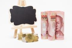 Bankbiljetten en muntstukken Royalty-vrije Stock Foto's