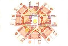 Bankbiljetten en muntstukken Stock Foto's