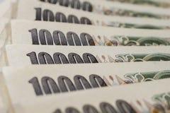 Bankbiljetten van de Japanse achtergrond van de Yenmunt stock afbeeldingen