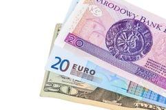 Bankbiljetten van 20 dollar zloty euro en poetsmiddel Royalty-vrije Stock Foto's
