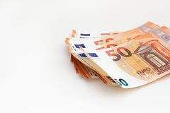 Bankbiljetten van het pak de euro geld op witte achtergrond euro contant geldachtergrond De besparingenconcept van het geld stock fotografie