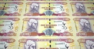 Bankbiljetten van vijf honderd Jamaicaanse dollars die van Jamaïca, contant geldgeld, lijn rollen stock illustratie