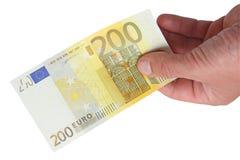 Bankbiljetten in zijn hand Stock Foto's