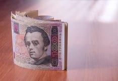 Bankbroodje van Oekraïense hryvnia op de lijst Stock Afbeelding