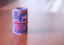 Bankbroodje van Oekraïense hryvnia op de lijst Stock Foto