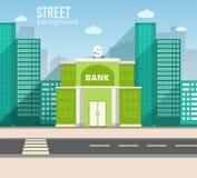 Bankbyggnad i stadsutrymme med vägen på lägenhet Arkivfoton