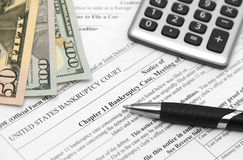 Bankcruptcy form. Bankruptcy form with money and calculator Stock Photo