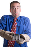 Banker. A young banker holding onto his calculator with oven mitts, isolated against a white background Stock Photo