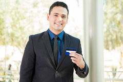 Banker with a credit card Royalty Free Stock Photo