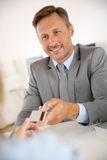 Banker with grey suit holding credit card Stock Images