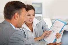 Banker looking at financial results Stock Images