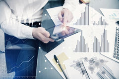 Banker manager working process.Photo analyst trader work market graphs.Using electronic devices.Graphic icons,worldwide Royalty Free Stock Photos