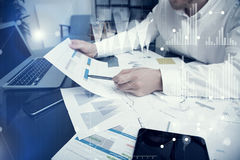 Banker manager working process.Photo bank trader work market charts.Using electronic devices.Graphic icons,worldwide Stock Photo