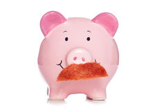 Banker moustache piggy bank Royalty Free Stock Photography