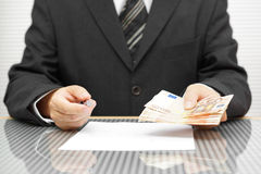 Banker offering money if you sign contract Stock Photo