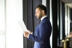 Banker reading contracts royalty free stock photo