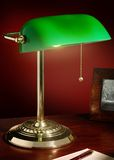 Banker's Lamp Brass. Antique brass finished banker's lamp with a green glass shade Stock Photography