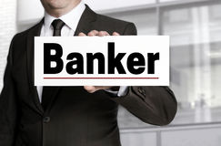 Banker sign is held by businessman concept Stock Photos
