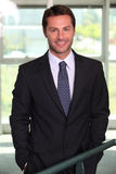 Banker standing in agency stock image