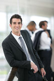 Banker standing in a hall. Smiling banker standing in a hall Royalty Free Stock Image