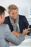 Banker student loans for student. Young men meeting financial adviser Stock Photos