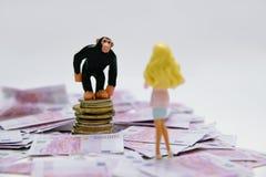 Banker und Geldnehmer Lizenzfreie Stockfotos