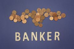 Banker written with wooden letters on a blue background. To mean a business concept Royalty Free Stock Photo