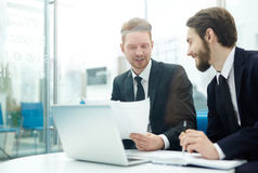 Bankers at briefing. Briefing of two young financial managers Stock Image