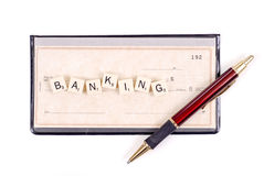 Banking. Spelled Out on Personal Check with Pen Stock Photos
